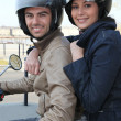 Stock Photo: Couple riding motorcycle