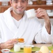 Man having breakfast in dressing gown — Foto de Stock