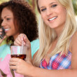 Two female friends having drink on terrace — Stock Photo