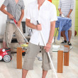 Young men doing household chores — Stock Photo