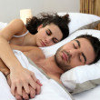 Couple asleep in bed — Stock Photo #8656245