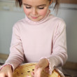 Little girl preparing pancakes — Stock Photo