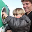 Father and son at a bottle bank — Stock Photo