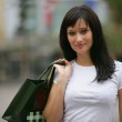 Woman on successful shopping trip — Stock Photo