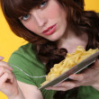 Woman eating tagliatelle - Stock Photo