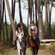 Twosome of horse riders — Stock Photo