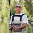 Stock Photo: Freshwater fishermin river