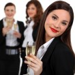 Business women drinking champagne — Stock Photo
