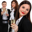 Stock Photo: Business women drinking champagne