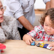 Stock Photo: Grandmother and little boy playing