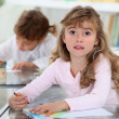 Stock Photo: Two kids studying in a classroom