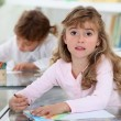 Two kids studying in a classroom — Stock Photo #8657314