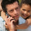 Man on phone with little metis boy — Stock Photo #8658021