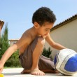 Little boy sitting with a ball — Stock Photo