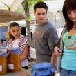 Young shopping in a market — Stock Photo