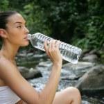 Woman drinking fresh spring water — Stock Photo