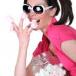 Candy-sweet woman with a jar a marshmallows — Stock Photo