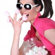 Stock Photo: Candy-sweet womwith jar marshmallows