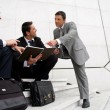 Stock Photo: Male businessmen on steps