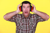 Craftsman wearing headphones can't stand the noise — Stock Photo