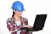 Female architect correcting designs — Stock Photo