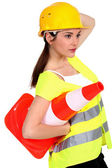 A traffic controller carrying a pylon — Stock Photo