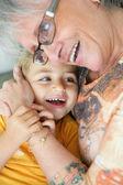 Woman hugging her grandchild — Stock Photo
