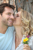 Couple with wild flowers — Stock Photo