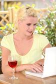 Platinum blonde and laptop — Stock Photo
