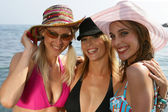Portrait of three women at the beach — Stock Photo