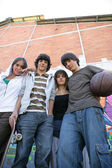Group of teenagers in the street — Stock Photo
