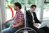 Men sitting on the bus — Stock Photo