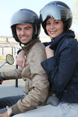 Couple riding a motorcycle — Stock Photo