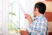 Man looking out window — Stock Photo