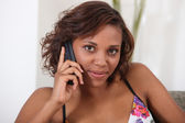 Pretty Metis woman on phone at home — Stock Photo