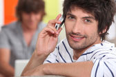 Portrait of handsome guy with cell phone — Stock Photo