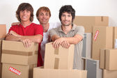 Young men on moving day — Stock Photo