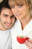 Young couple having an early morning cup of coffee — Stock Photo
