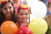 Happy little girls at birthday party — Stock Photo