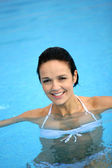 Brunette wading in pool — Stock Photo