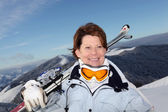 Middle-aged woman skiing on mountain — Stock Photo