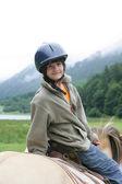 Little boy riding horse — Stock Photo