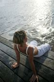 Woman dipping her feet into the water — Stock Photo