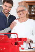 Senior with handyman — Stock Photo