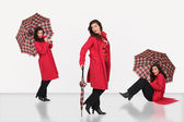 Woman wearing umbrella — Stock Photo