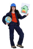 Female heating engineer holding globe — Stock Photo