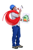 Man with a loudspeaker and household energy rating sign — Stock Photo