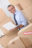 Warehouse manager with boxes — Stock Photo