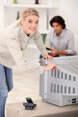 Woman removing the back of a tv set — Stock Photo