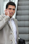 Young man with cellphone outdoors — Stock Photo